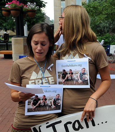 "Shannon Bauer, left, reads a statement with Natalie Senske. Shannon's brother has been held in Iran for a year.<br /> Friends an family of the hikers held in Iran, Shane Bauer, Sarah Shoud and Josh Fattal, held a vigil on the Pearl Street Mall. The three have been imprisoned for a year.<br /> For more photos  and a video of the vigil, go to  <a href=""http://www.dailycamera.com"">http://www.dailycamera.com</a><br />  Cliff Grassmick / July 31, 2010"