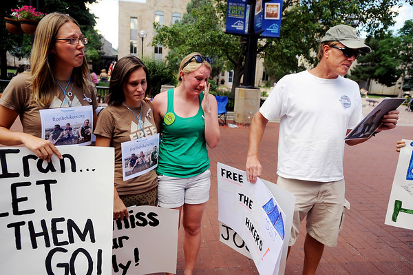 "Craig Petersen, right, reads a statement by Barbara Petersen, to his right, who couldn't control her emotions, as Natalie Senske, left, and Shannon Bauer listen.<br /> Friends an family of the hikers held in Iran, Shane Bauer, Sarah Shoud and Josh Fattal, held a vigil on the Pearl Street Mall. The three have been imprisoned for a year.<br /> For more photos  and a video of the vigil, go to  <a href=""http://www.dailycamera.com"">http://www.dailycamera.com</a><br />  Cliff Grassmick / July 31, 2010"