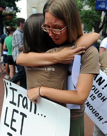 """Shannon Bauer, left, hugs Natalie Senske at the vigil. Shannon's brother has been held in Iran for a year.<br /> Friends an family of the hikers held in Iran, Shane Bauer, Sarah Shoud and Josh Fattal, held a vigil on the Pearl Street Mall. The three have been imprisoned for a year.<br /> For more photos  and a video of the vigil, go to  <a href=""""http://www.dailycamera.com"""">http://www.dailycamera.com</a><br />  Cliff Grassmick / July 31, 2010"""