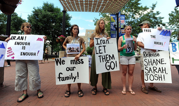 "Sarah Kubley, left, Shannon Bauer, Natalie Senske, Barbara Petersen and Craig Petersen,  address people about their friends and family held in Iran.<br /> Friends an family of the hikers held in Iran, Shane Bauer, Sarah Shoud and Josh Fattal, held a vigil on the Pearl Street Mall. The three have been imprisoned for a year.<br /> For more photos  and a video of the vigil, go to  <a href=""http://www.dailycamera.com"">http://www.dailycamera.com</a><br />  Cliff Grassmick / July 31, 2010"