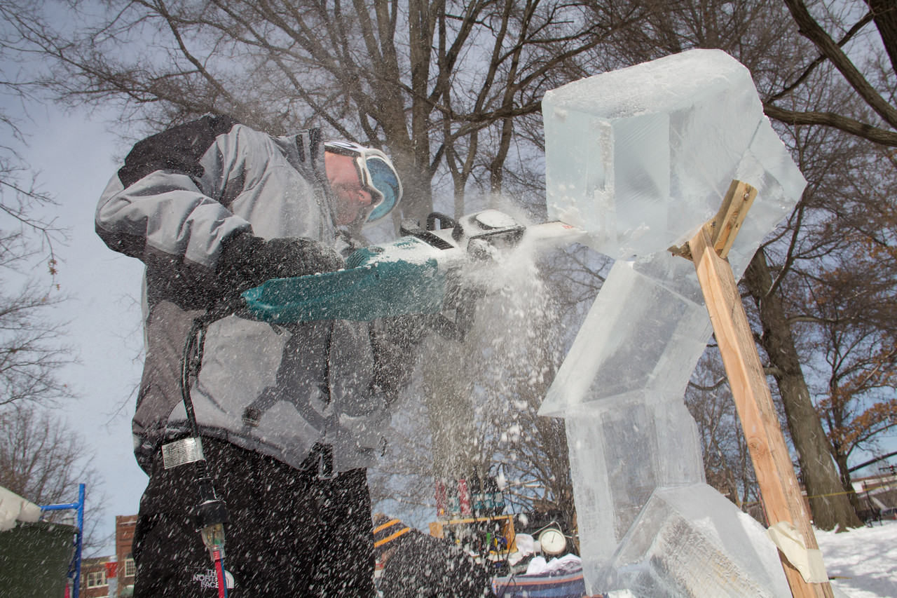 ALEC SMITH / GAZETTE John Dreslinskey from Stow was a member of a University of Akron ice sculpture team that participated in events Sunday at the 22nd Ice Festival on Medina's Public Square.