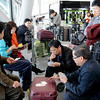 Uruguay Chile Volcano.JPEG-.JPG Chinese passengers play cards as they wait at Carrasco Airport where flights were canceled due to a volcanic ash cloud that reached Uruguay's capital grounding most air travel in Montevideo, Uruguay,Thursday, June 9, 2011. The wind carried volcanic ash to Uruguay after the Chilean Puyehue-Cordon Caulle volcano erupted Saturday, resulting in the closing of six airports, and the cancellation of flights. (AP Photo/Matilde Campodonico)