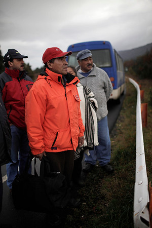 Chile Volcano.JPEG-0fc84.JPG Residents of El Caulle look at the mountains near the border cross way Cardenal Samore, which connects Chile and Argentina, after the eruption of the Puyehue-Cordon Caulle volcano in Chile, Wednesday, June 8, 2011. The volcano erupted Saturday after remaining dormant for decades, causing the evacuation of about 3,500 people in the nearby area and carrying ash across the Andes to Argentina. (AP Photo/Roberto Candia)