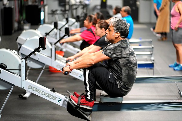 BEN GARVER — THE BERKSHIRE EAGLE<br /> Jose Delgado uses a rowing machine during a class at CrossFit in Great Barrington, Friday, January 4, 2019. Volunteers in Medicine is partnering with CrossFit Great<br /> Barrington to bring healthy habits and exercise to the nonprofit's<br /> low income patients who are at high risk of illness.