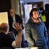 KRISTOPHER RADDER — BRATTLEBORO REFORMER<br /> Emilie Kornheiser listens to instructions before casting her ballot at the Brattleboro American Legion during the Midterm election on Tuesday, Nov. 6, 2018.
