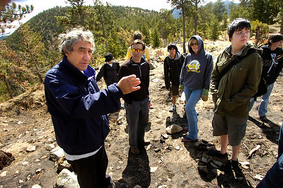 Homeowner Gunther Weil, far left, talks about how the Fourmile Fire burned around his home to faculty, parents and students of the Watershed School on a 3 day project by the school to reseed areas of the FourMile Fire burn area in the Sugarloaf Mountain Area. In foreground to Weil's left is Jason Berv, Head of Watershed School, parent Traci Hoops and student Calais Harding. The students were working on Weil's property. For more photos and a video of the project go to www.dailycamera.com Photo by Paul Aiken / The Camera / April 19, 2011