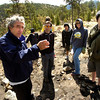 "Homeowner Gunther Weil, far left, talks about how the Fourmile Fire burned around his home to faculty, parents and students of the Watershed School on a 3 day project by the school to reseed areas of the FourMile Fire burn area in the Sugarloaf Mountain Area. In foreground to Weil's left is Jason Berv, Head of Watershed School, parent Traci Hoops and student Calais Harding. The students were working on Weil's property.<br /> For more photos and a video of the project go to  <a href=""http://www.dailycamera.com"">http://www.dailycamera.com</a><br /> Photo by Paul Aiken / The Camera / April 19, 2011"