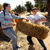 "Ada Kakatsakis, left, and Soren Peterson, students at the Watershed School, carries straw bales to be placed on top of reseeded areas as part of  a 3 day project by the school to reseed areas of the Fourmile Fire burn area in the Sugarloaf Mountain Area. For more photos and a video of the project go to  <a href=""http://www.dailycamera.com"">http://www.dailycamera.com</a><br /> Photo by Paul Aiken / The Camera / April 19, 2011"