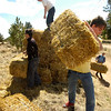 "Jeffrey Harvey, a student at the Watershed School, carries straw bales to be placed on top of reseeded areas as part of  a 3 day project by the school to reseed areas of the Fourmile Fire burn area in the Sugarloaf Mountain Area. For more photos and a video of the project go to  <a href=""http://www.dailycamera.com"">http://www.dailycamera.com</a><br /> Photo by Paul Aiken / The Camera / April 19, 2011"