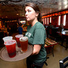 "Kelly Hughes, a Linguistics and Communications Senior at the University of Colorado carries a load of drinks during the lunch rush at the Sink on University Hill in Boulder on Monday afternoon July 16, 2012. Hughes works 30 plus hours a week while taking a full load of classes. For more photos and a video of the working college students go to  <a href=""http://www.dailycamera.com"">http://www.dailycamera.com</a><br /> Photo by Paul Aiken"