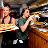 "Courtney Popelka, left, and Kelly Hughes both students at the University of Colorado deliver orders during the lunch rush at the Sink on University Hill in Boulder on Monday afternoon July 16, 2012. Both students work 30 plus hours a week while taking a full load of classes. <br /> For more photos and a video of the working college students go to  <a href=""http://www.dailycamera.com"">http://www.dailycamera.com</a><br /> Photo by Paul Aiken"