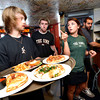 "Kelly Hughes, a Linguistics and Communications Senior at the University of Colorado gives food delivery instructions to fellow student  Evan Almon, at left during the lunch rush at the Sink on University Hill in Boulder on Monday afternoon July 16, 2012. Both Hughes and Almon work at the restaurant while taking a full load of classes. Trainee Bernie Conley, center, looks on.For more photos and a video of the working college students go to  <a href=""http://www.dailycamera.com"">http://www.dailycamera.com</a><br /> Photo by Paul Aiken"