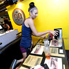 "Courtney Popelka, a student at the University of Colorado clears tables during the lunch rush at the Sink on University Hill in Boulder on Monday afternoon July 16, 2012. Popelka works 30 hours a week at the restaurant while taking on a full school workload of classes. <br /> For more photos and a video of the working college students go to  <a href=""http://www.dailycamera.com"">http://www.dailycamera.com</a><br /> Photo by Paul Aiken"
