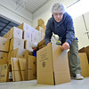 20120225_KENYA_313.jpg Kevin Long, of Longmont, tapes boxes that would later be filled with prepared meals, made up of rice, soy and dehydrated vegetables, to be shipped to Kenya during the Kids Around the World Kare for Kenya project in Gunbarrel on Saturday, February 25, 2012.  Each box contains 36 packages and feeds 216 children, according to the Kids Around the World program.<br /> <br /> (Greg Lindstrom/Times-Call)
