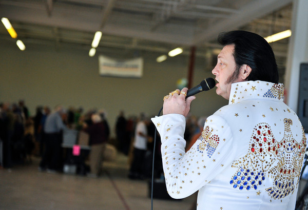 20120225_KENYA_587.jpg Elvis Tribute Artist Steve Creason provides some entertainment for volunteers as they prepare 125,000 meals, made up of rice, soy and dehydrated vegetables, to be shipped to Kenya during the Kids Around the World Kare for Kenya project in Gunbarrel on Saturday, February 25, 2012.<br /> <br /> (Greg Lindstrom/Times-Call)