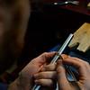 KRISTOPHER RADDER — BRATTLEBORO REFORMER<br /> Will Nevins-Alderfer, co-owner of W.R. Metalarts, checks the measurements on the engagement ring.