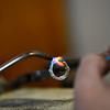 KRISTOPHER RADDER — BRATTLEBORO REFORMER<br /> Will Nevins-Alderfer, co-owner of W.R. Metalarts,  solders the diamond setting onto the ring.