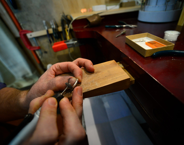KRISTOPHER RADDER — BRATTLEBORO REFORMER<br /> Will Nevins-Alderfer, co-owner of W.R. Metalarts,  polishes the ring.