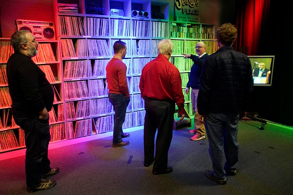 BEN GARVER — THE BERKSHIRE EAGLE<br /> David Cachet of PCTV talks with visitors in front of the WTBR record collection lining one of the studios as WTBR went back on the air,  Thursday, January 3, 2019.