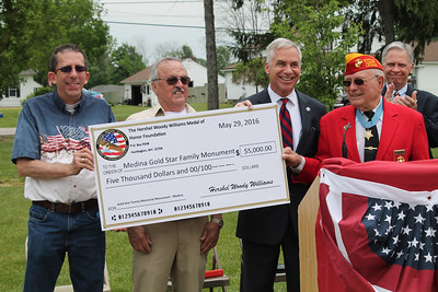 "LAWRENCE PANTAGES / GAZETTE The Hershel ""Woody"" Williams Medal of Honor Foundation made a $5,000 donation Sunday at ceremonies in York Township toward the construction of a $100,000 Gold Star Families Foundation monument to honor the sacrifice of fallen military men and women from Northeast Ohio. Shown from left are: York Township trustee William Pavlick, Medina monument organizer Mickey Kennedy, Medina Mayor Dennis Hanwell, Williams and Ohio Rep. Steve Hambley."
