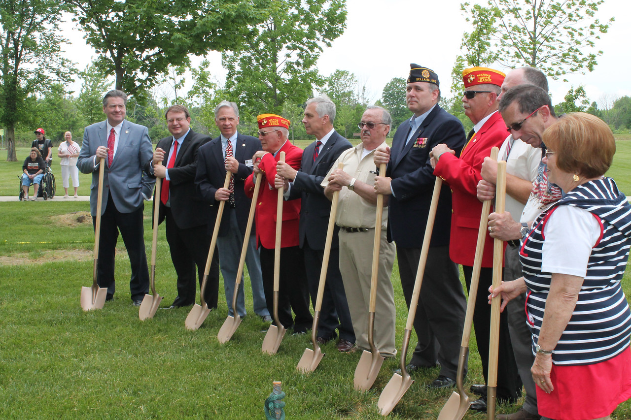 "LAWRENCE PANTAGES / GAZETTE A ceremonial groundbreaking was held Sunday at the town hall park area in York Township to celebrate the start of construction of a $100,000 Gold Star Families Foundation monument to honor fallen military service men and women from Northeast Ohio. From left are: Ohio Sen. Thomas Patton; Ohio Sen. Larry Obhof; Ohio Rep. Steve Hambley; Hershel ""Woody"" Williams; Medina Mayor Dennis Hanwell; Medina monument organizers Mickey Kennedy and Jeff Klaas; Marine Corps League Junior Vice Commandant John W. Harkness and York Township trustees Richard Monroe, William Pavlick and Colene Conley."
