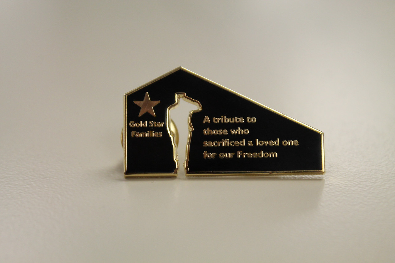LAWRENCE PANTAGES / GAZETTE Lapel pins were presented to some audience members who attended a Memorial Day weekend ceremony in York Township.
