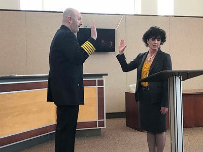 NATHAN HAVENNER/ GAZETTE  Robert Lindner, 43, is sworn in as the 16th fire chief of the city of Wadsworth at city hall Monday by Mayor Robin Laubaugh. Lindner has been serving as interim-chief since January.