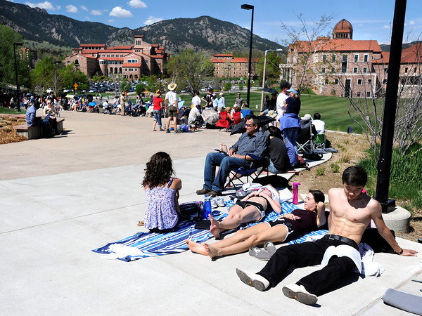 "University of Colorado freshman Aidar Aralbayev, right, Jasmine Galimov, Emily Sherwood and Hailey Badovinac lay in the sun while waiting in line for tickets to see President Obama speak on Monday, April 23, at the Coors Event Center on the University of Colorado campus in Boulder. For more photos and video of people waiting in line for Obama tickets go to  <a href=""http://www.dailycamera.com"">http://www.dailycamera.com</a><br /> Jeremy Papasso/ Camera"