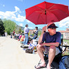 "Jerry Ohrt, of Louisville, uses an umbrella to shield himself from the sun while waiting in line for tickets to see President Obama speak on Monday, April 23, at the Coors Event Center on the University of Colorado campus in Boulder. For more photos and video of people waiting in line for Obama tickets go to  <a href=""http://www.dailycamera.com"">http://www.dailycamera.com</a><br /> Jeremy Papasso/ Camera"