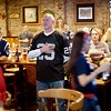 BEN GARVER — THE BERKSHIRE EAGLE<br /> Tony Clement listens to Pink sing The National Anthem before the Super Bowl, watching at the Hot Dog Ranch in Pittsfield