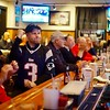 BEN GARVER- THE BERKSHIRE EAGLE<br /> Rich Powell pumps his first as the Patriots gain ground during the Super Bowl, watching from the Hot Dog Ranch in Pittsfield.