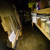 KRISTOPHER RADDER — BRATTLEBORO REFORMER<br /> Crews pump out nearly five feet of water from the basement of Penelope Wurr Retail Store and Brattleboro Bicycle Shop, on Main Street, on Tuesday, Feb. 5, 2019.