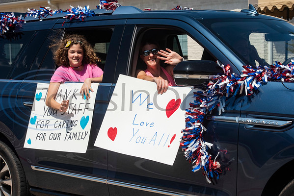 Family members of residents of Wateron at Shiloh, a healthcare, rehabilitation and assisted living center, drive in Mother's Day themed parade at the facility in Tyler on Thursday, May 7, 2020. Families of residents were encouraged to join the parade to celebrate the upcoming Mother's Day holiday as visitors are not allowed inside their facilities at this time due to COVID-19 precautions.