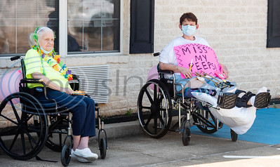 Residents of Wateron at Shiloh, a healthcare, rehabilitation and assisted living center, sit outside the building in Tyler for a Mother's Day parade on Thursday, May 7, 2020. Families of residents were encouraged to join the parade to celebrate the upcoming Mother's Day holiday as visitors are not allowed inside their facilities at this time due to COVID-19 precautions.