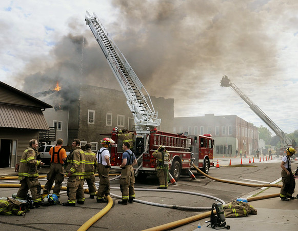 Smoke pours from the back of the Rogers Building in Waterville on Thursday. The historic building and attached apartments were destroyed in the fire. Photo by John Cross