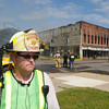 Waterville fire chief Chris Meskan talks to media about a fire that destroyed the historic Rogers Building there on Thursday. Photo by John Cross