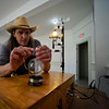 KRISTOPHER RADDER — BRATTLEBORO REFORMER<br /> Quintron, an artist from New Orleans, fills up a weatherglass barometer with water as he prepares his Weather Warlock on Thursday, Aug. 29, 2019. The Weather Warlock creates music and sounds from differences in weather.