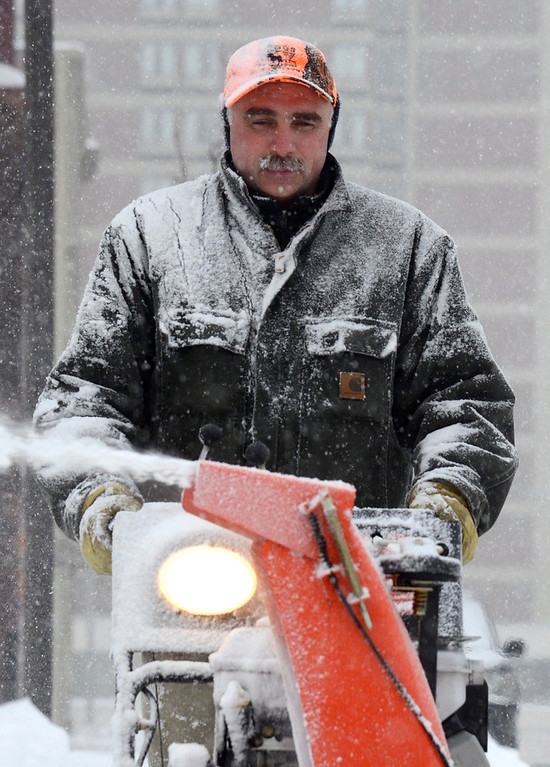 . Don Scace is covered in snow as he cleans the sidewalk at Berkshire Bank in Pittsfield with a snowblower, Wednesday Feb. 5, 2014.  Photo by Ben Garver / Berkshire Eagle Staff