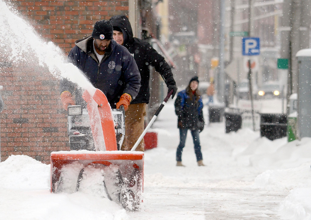 . Pittsfield City workers Jamie Gardner and Keenan Pallas clean the snow off of Persip Park,  Wednesday Feb.  5, 2014.  Photo by Ben Garver / Berkshire Eagle Staff
