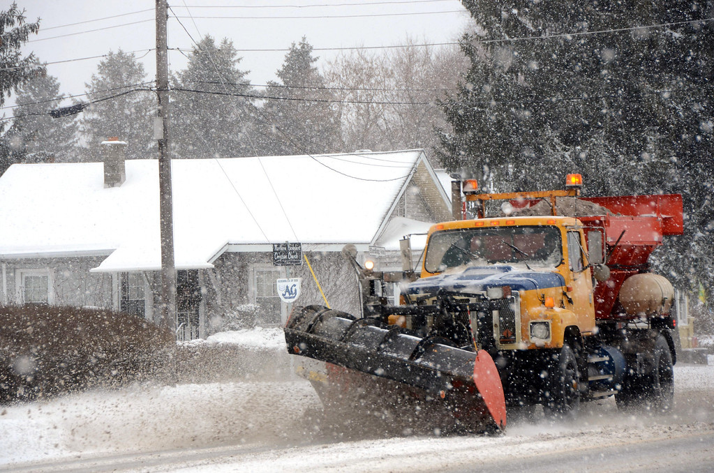 . A snowplow travels along State Road in North Adams during the height of the snowstorm on Wednesday, Feb. 5, 2014. Gillian Jones/Berkshire Eagle Staff