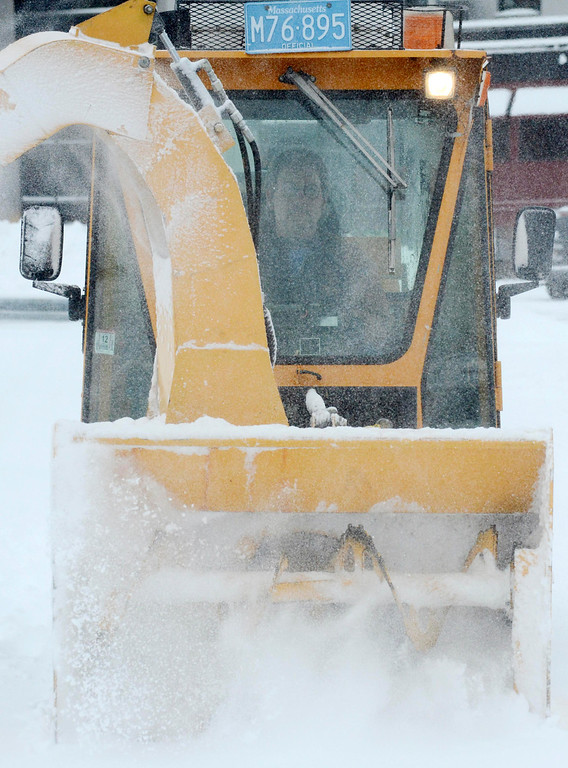 . Pittsfield city worker Ed Kuni uses a trackless snowblower to clean the sidewalks on Depot Street in Pittsfield, Wednesday Feb. 5, 2014.  Photo by Ben Garver / Berkshire Eagle Staff
