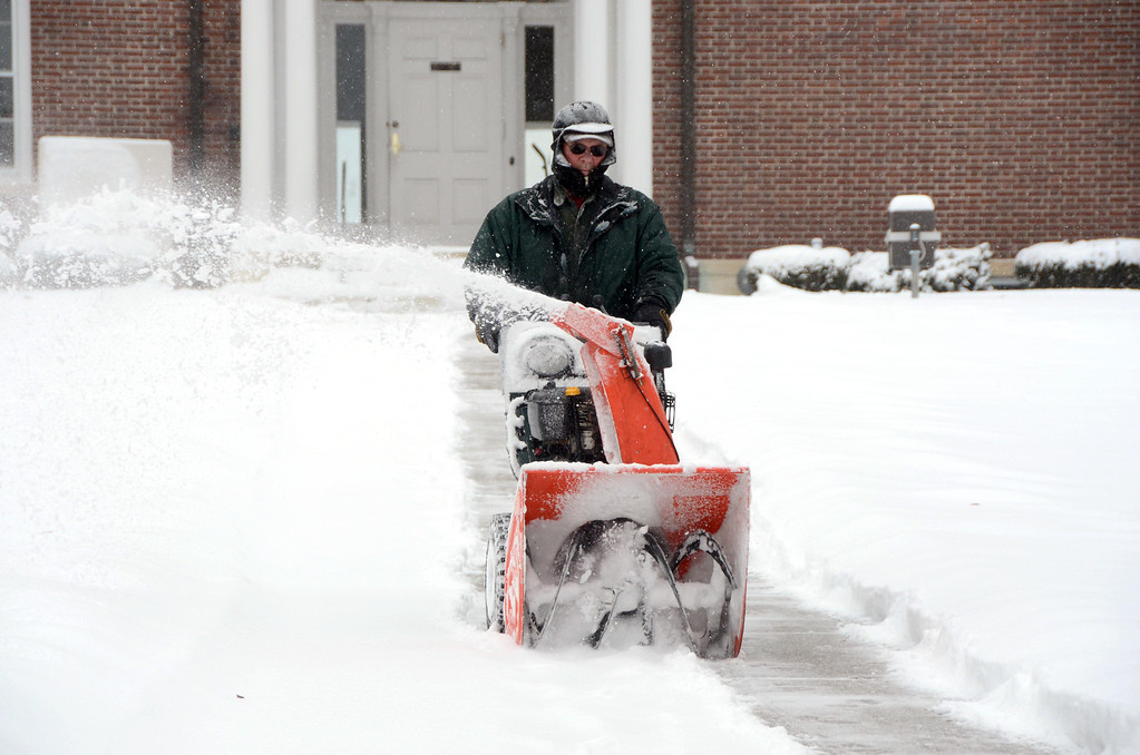 . Gary Green snowblows the sidewalk in front of Town Hall on Park Street in Adams on Wednesday, Feb. 5, 2014. Many munipical offices were closed due to the storm. Gillian Jones/Berkshire Eagle Staff