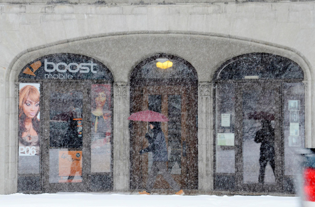 . A pedestrian passes a North Street Storefront in Pittsfield during heavy morning snow, Wednesday Feb. 5, 2014.  Photo By Ben Garver / Berkshire Eagle Staff