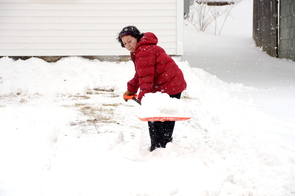 . Maria Oriva shovels the snow from the front yard of her daughter\'s Massachusetts Avenue home in North Adams on Wednesday, Feb. 5, 2014. Gillian Jones/Berkshire Eagle Staff