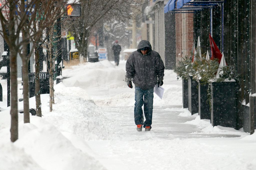 . A man walks on North Street in Pittsfield among piles of freshly fallen snow, Wednesday Feb 5, 2014.  Photo by Ben Garver / Berkshire Eagle Staff