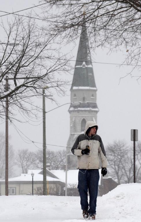 . Gergory Cyr walks on Bradford Street during the snowfall, Wednesday Feb. 5, 2014.  Photo by Ben Garver / Berkshire Eagle Staff