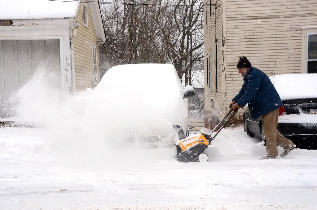 . Alex Brooks of Massachusetts Avenue in North Adams snowblows the sidewalk in front of his home on Wednesday, Feb. 5, 2014. Gillian Jones/Berkshire Eagle Staff