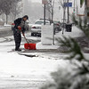 Peter Dobransky of Pittsfield shovels snow on the sidewalk of North St. Tuesday afternoon. December 10th 2013 Holly Pelczynski/Berkshire Eagle Staff