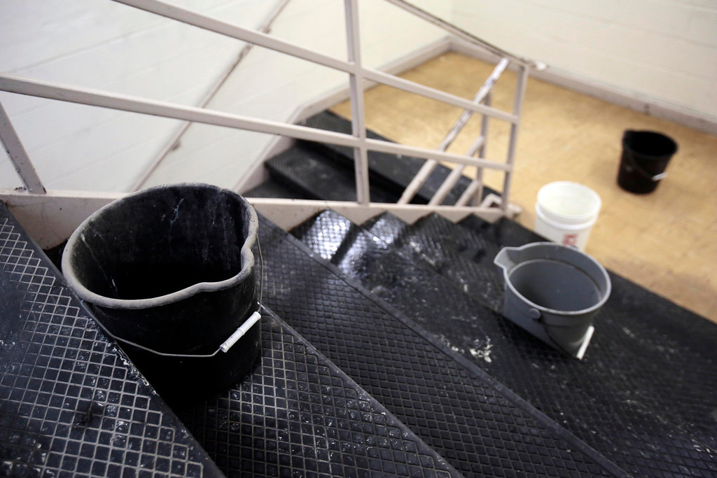 . Buckets on a closed stairwell due to the leaking catch water at Taconic High School in Pittsfield. Thursday, March 20, 2014. Stephanie Zollshan / Berkshire Eagle Staff / photos.berkshireeagle.com
