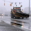 A plow drives on Dalton Ave. on Monday afternoon, while temperatures and weather changes dramatically with rain and snow coming to the Berkshires. (January 6th 2014 Holly Pelczynski/Berkshire Eagle Staff)